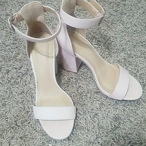 Light pink platforms with ankle strap.  Size 6